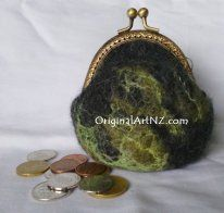 Pretty clapsed coin purse made from NZ merino wool, embellished with silk.