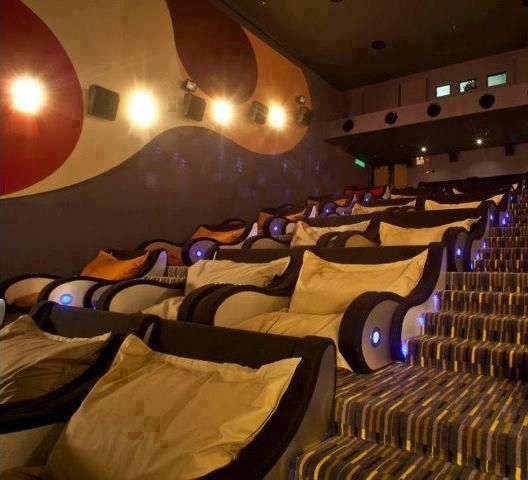 Theatre Seats - Isn't that great? We vote yes! It's a must in every home (of a billioner or something..)