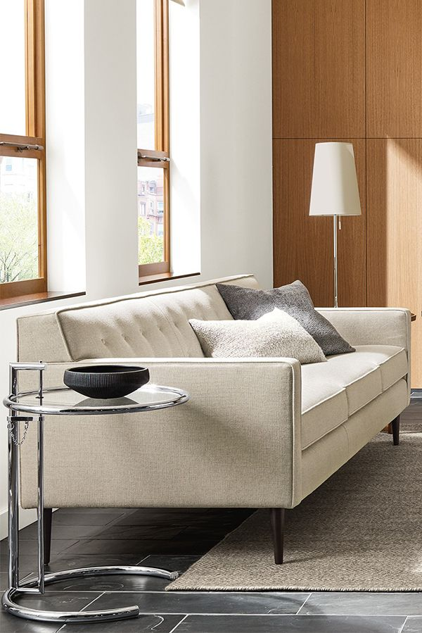 Recliner Sofa Expertly tailored details elevate the Holmes sofa from retro to refined
