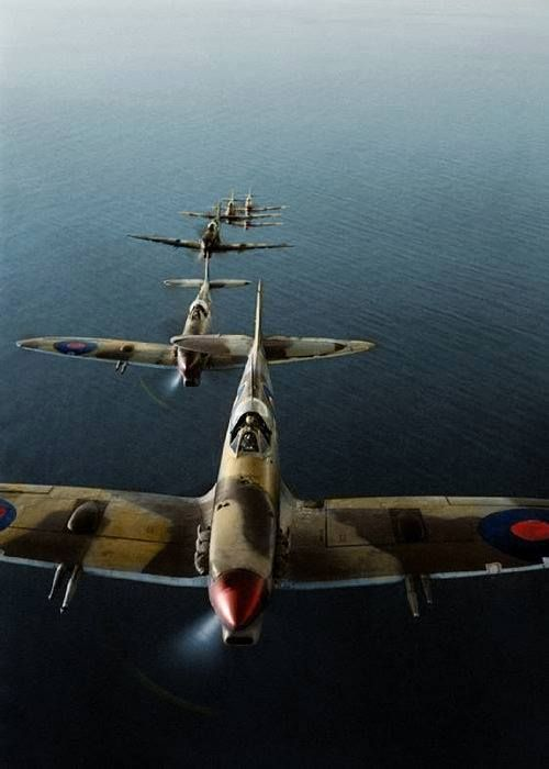 Supermarine Spitfire Mark VCs of No. 2 Squadron South African Air Force (SAAF) based at Palata, Italy, flying in loose line astern formation over the Adriatic Sea while on a bombing mission to the Sangro River battlefront. Oct-Dec 1943 (© IWM CNA 2102)  (Colorised by Tom Thounaojam from Imphal in India)