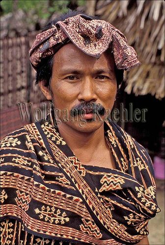 Indonesia, sawu (Seba) Island village, portrait of local man in traditional ikat…