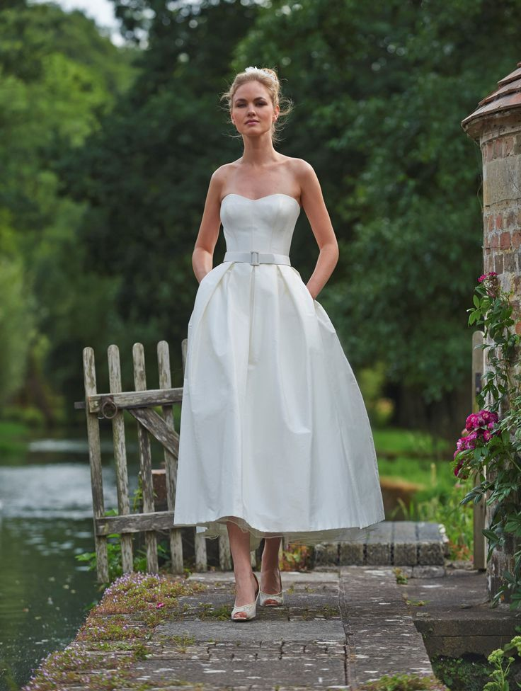 Stephanie Allin - Symphony bodice and midi skirt.  The symphony bodice is simple and stunning in plain silk to show off an incredibly flattering fit. Pair with the box pleated midi skirt for a chic bridal two piece in sumptuous silk.