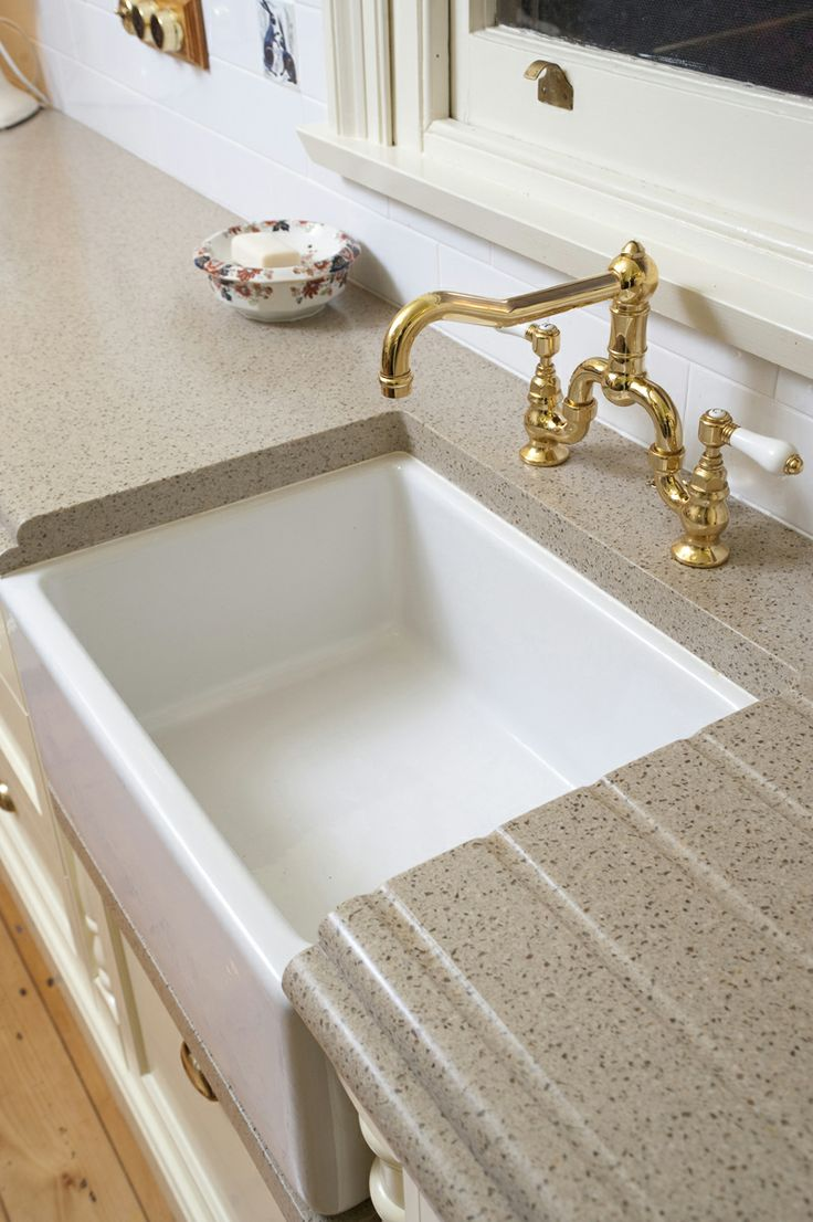 Superb Staron Solid Surface Countertop With Built In Drain Board Near The Sink.  Perfect For A Kitchen Renovation!