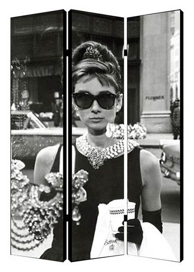 Audrey Hepburn is looking into the window of the famous jewelry store in the iconic opening scene of Breakfast at Tiffany's in this folding screen room divider.