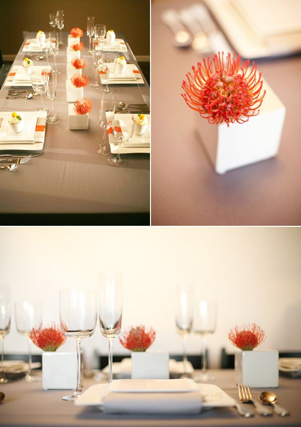 White ceramic cubes display unique orange pincushion protea blooms. Floral and styling by Liz Rusnac of Fleur:ology. Photo by Diana Radoi of Diana Marie Photography. Via www.bklynbrideonline.com.