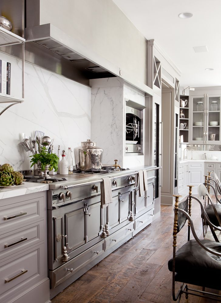 Amazing Gray Kitchen With Rustic Wood Floors, Marble Backsplash, And La Cornue  Range.
