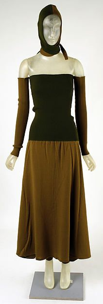 Brown wool knit ensemble (turtleneck dress, thigh-high legwarmers, skirt and strapless top with detached sleeves, wrap hood), by Giorgio di Sant'Angelo, American, fall/winter 1988-89.