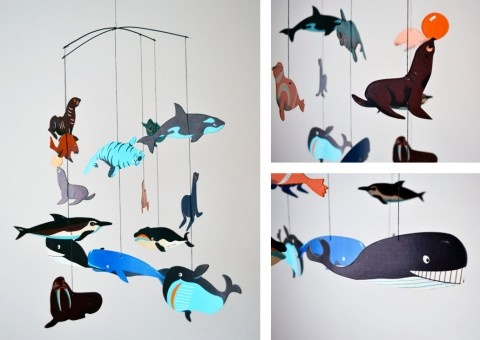 I like the idea of buying those lightweight wooden cut-out shapes from the craft store and painting them myself to make a mobile