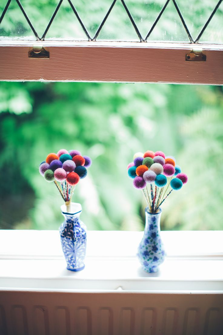 Mine and my Maid of Honour's bouquets. Handmade Felt balls attached to fabric wrapped wire. #DIY #WeddingIdeas   Photo by Jason Valler