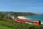 Take the single line rail track from St Ives to Hayle.  The train hugs the coastline with a superb elevated view of Carbis Bay beach and Porthkidney Sands.  At Hayle, enjoy an ice cream treat at Mr B's ice cream parlour.  #coast #seaside #Cornwall