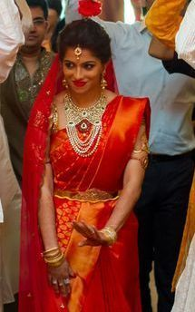 Shining Bride in Traditional Red Silk Saree