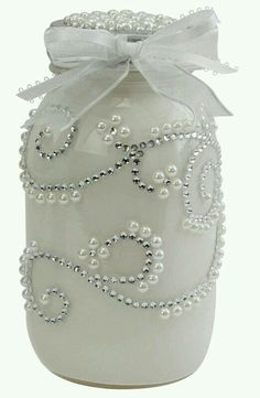 Pearls, white paint, rhinestones, lace ribbon and either a mason or baby food jar.   G;)