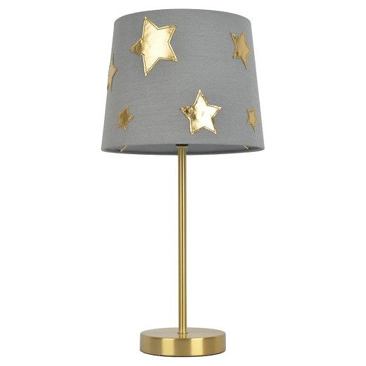 Light up the night with the Star Shade Table Lamp from Pillowfort. This star lamp has a gold tone stem and base with matching shiny stars in varying sizes scattered around the shade.