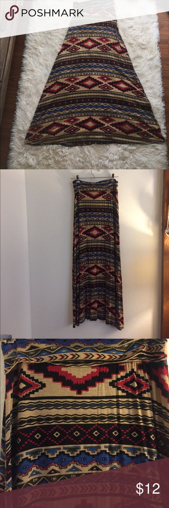Aztec Maxi Skirt! Super cozy maxi skirt! High waisted banded style which can be worn up or folded over as shown. Flowly slinky stretch material. Full long maxi length. Skirts Maxi