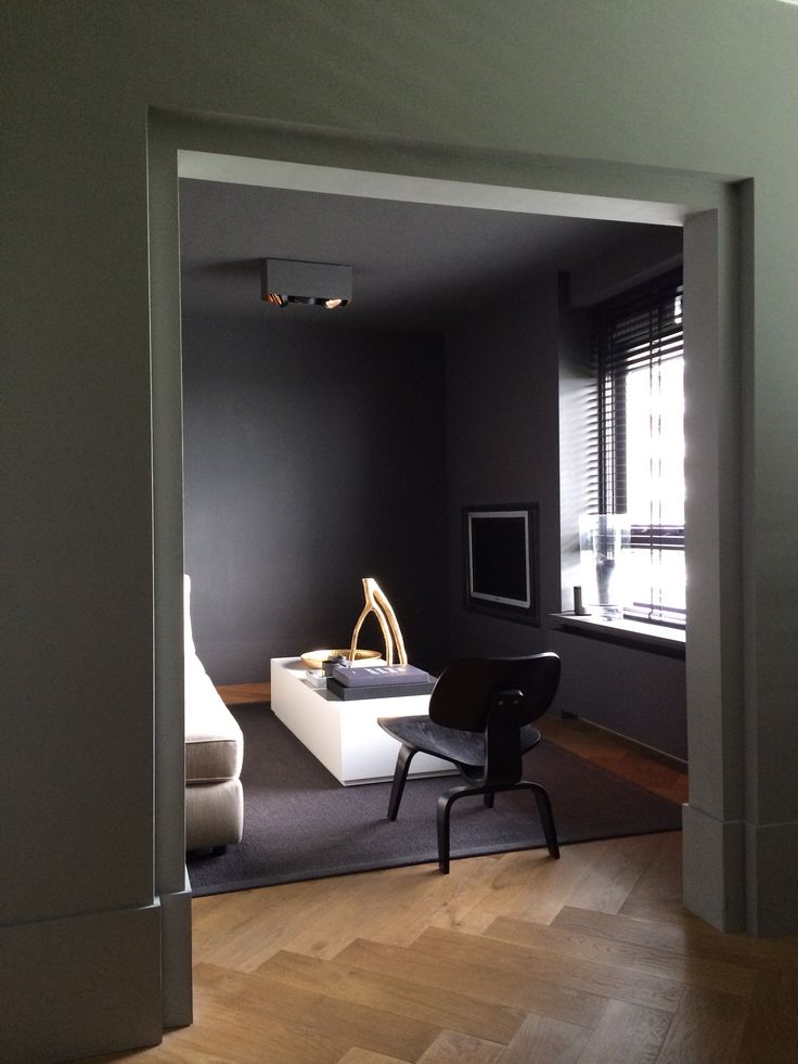 Lounge, shades of grey, Eames LCW chair, gold and marble