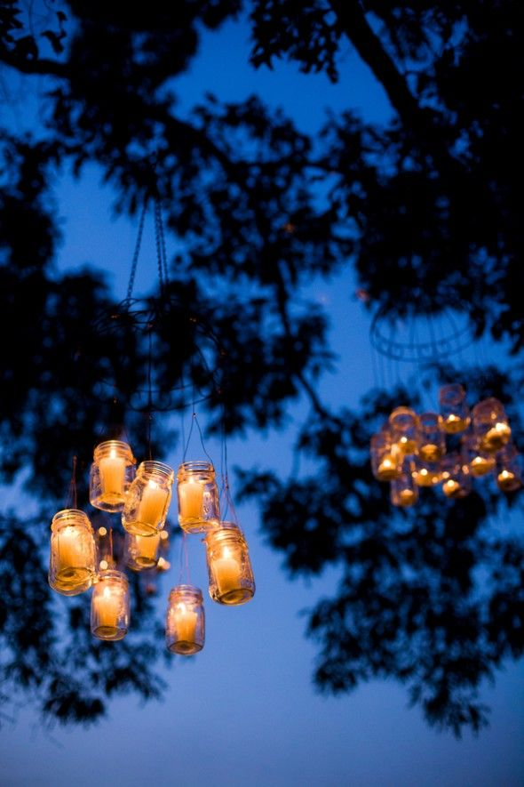 Hang mason jars candles in your garden
