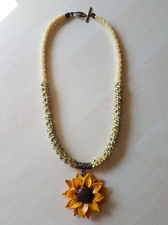 Sunflower necklace, made from Toho beads and fire polished czech beads. The pendant is also handmade, from polymer clay.  **NOTE** The color might be slightly different than the photo. Colors may vary from monitor to monitor due to individual settings and limitations in digital photography. Every effort is made to come as close as possible to actual colors in each item.