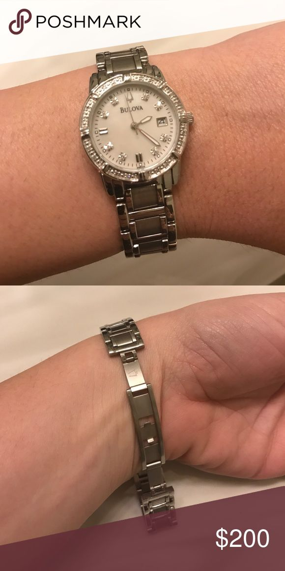 "Bulova Diamond Accent Watch Stainless steel bracelet watch. Bezel features 24 diamond accents; with a mother of pearl face, date window at 3 o' clock and sparkling diamond accent indexes. Quartz movement, and water resistant at 30 meters. Purchased from Macy's. This watch was rarely worn and has no noticeable damage or wear. Practically brand new! Removable links, and is about 9"" in circumference. Bulova Jewelry"