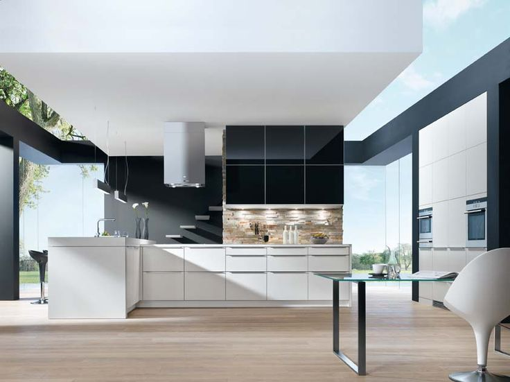 Kitchen showing Nouva matt laquer cabinets in white with wall units in black painted glass with aluminium framing