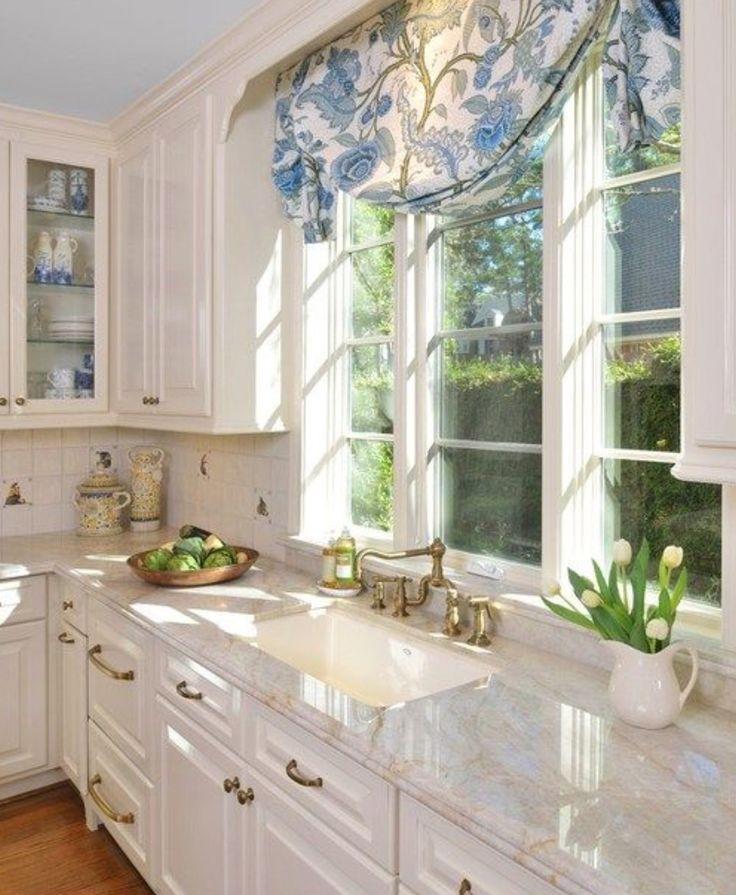 blue, white, brass, marble kitchen. Blue ceiling