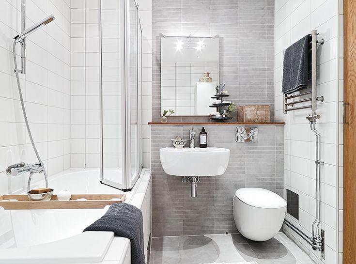 Lovely gray tiles. Wood. White.