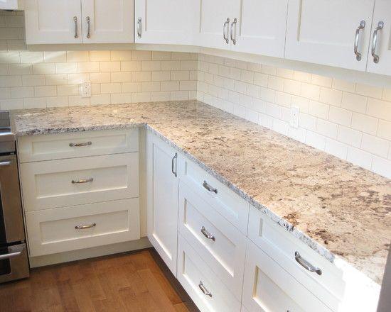 Kitchen Ideas Traditional Kitchen Cabinet Design With Alaskan White Granite Countertops Also White Tiling Backsplash