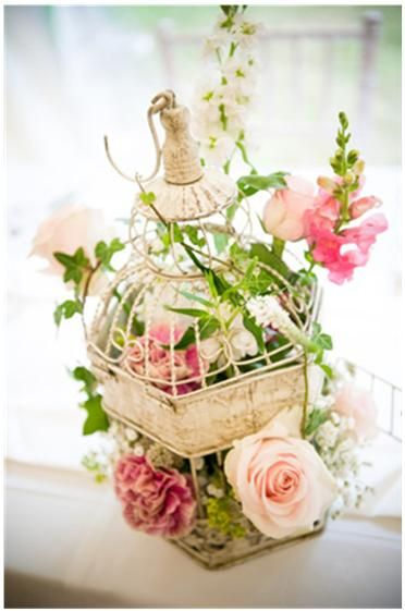 I'm thinking of finding old bird cages and decorate them with flowers and maybe candles/Hanna vintage birdcage with flowers #wedding #birdcage #bridal