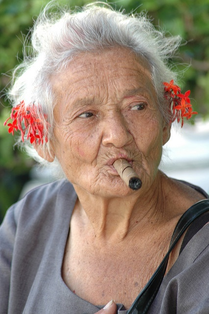Hermosa Cubana. I think she is beautiful even with that big cigar in her mouth. The fact that she does what she pleases and most likely doesn't care what anyone has to say about it inspires me to be who I am.