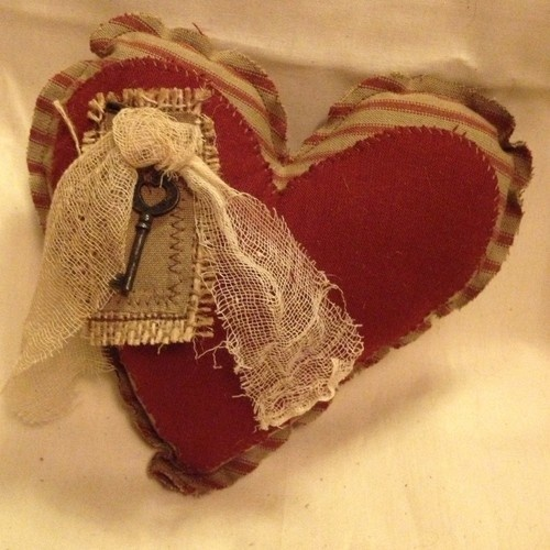 Primitive Valentine Burgundy Tickling Heart with Grungy Cheese Cloth and Key. Would be cute on an old oil can.