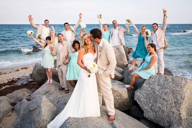Beach wedding party on rocks from Something Turquoise