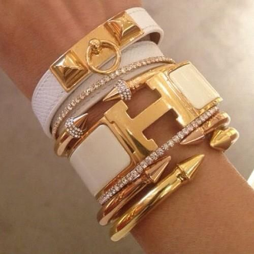 Hermes collection of white & gold bangle bracelets & cuffs