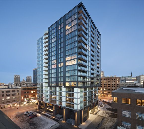 With its contemporary architecture, clean lines and bold presence within the new urban garden of Quebec city, the Fresk Tower brings a new living environment in the heart of the city center with 169 housing units.   Photo: Stéphane Groleau