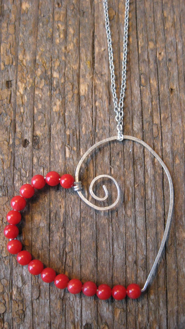 Crossley Design-Silver wire wrapped heart pendant with sea bamboo