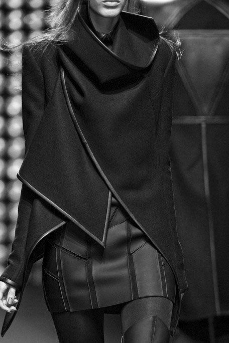 Asymmetric jacket with leather trim; graphic black fashion details // Gareth Pugh
