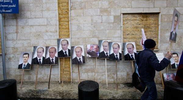 Regime supporters put Assad and Putin posters outside the Russian Embassy in Damascus.