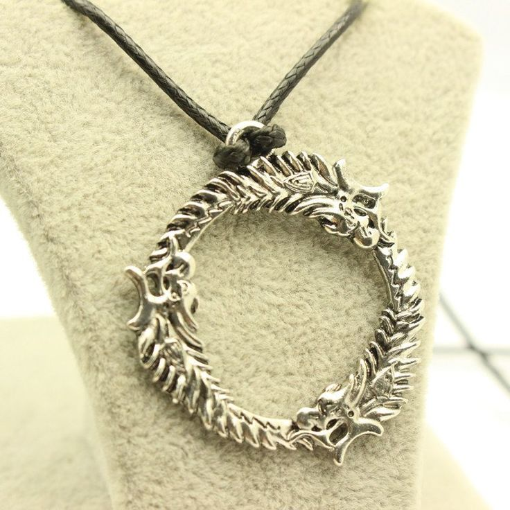 Get this Skyrim The Elder Scrolls Dragon Pendant Necklace and let the world know you're a Skyrim fan! Chain Length : 45cm INTERNET EXCLUSIVE - NOT SOLD IN STORES