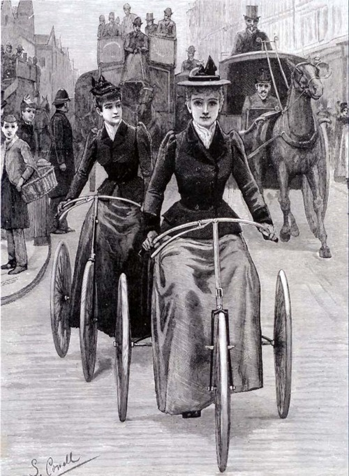 Ladies riding tricycle bikes through the city, date unknown.