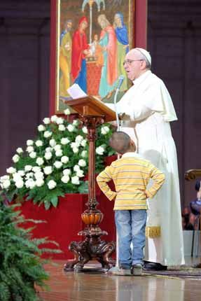 This little boy stayed on stage with Pope Francis during his homily to the crowd.  Pope Francis seemed to love it.