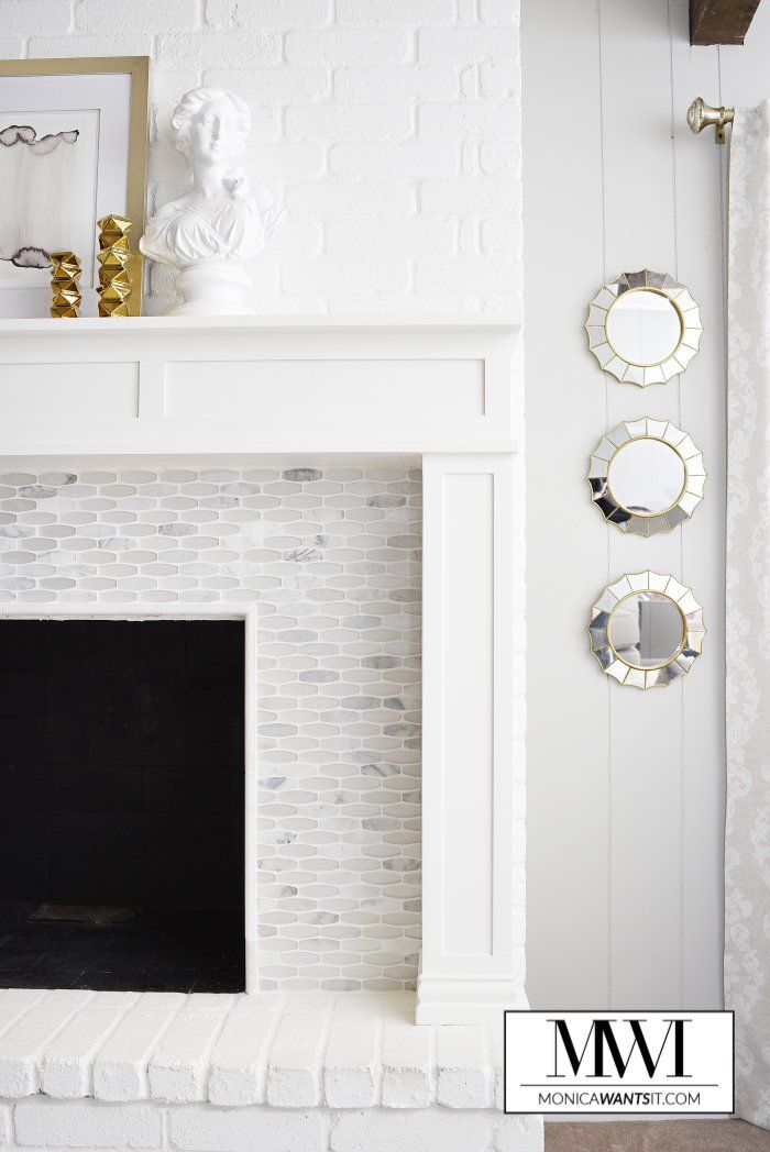 We love this gorgeous fireplace makeover by Monica Benavidez of Monica Wants It. Surrounding the fireplace you see Ellia Blanco glass and stone mosaic tile from MS International. Isn't it beautiful? Read more about this beautiful white-on-white fireplace and mantel makeover on Monica's blog.