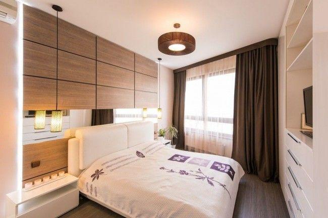 Темно-коричневые шторы в пол на всю стену идеально подходят для современного интерьера спальни молочно-бежевого цвета