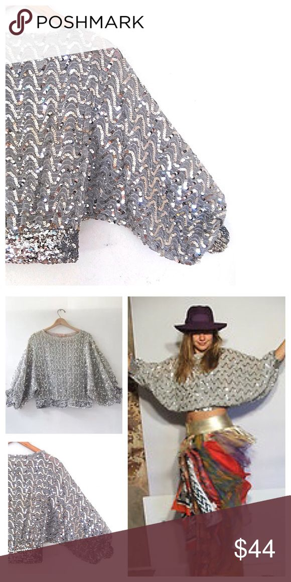 "VINTAGE Batwing Sequin Crop Top 70s Disco party top. This listing is for a super cute Adamo vintage shirt / vintage blouse. This adorable Disco era vintage shirt / vintage blouse features: Batwing Dolman sleeves, boatneck, zig zag silver and gold rope & sequins, stretch sequin waist and cuffs, semi sheer, made in USA Modern Size M L XL Bust: 44"" Length: 25""  This vintage shirt / vintage blouse is in excellent to near mint condition. Vintage Tops"