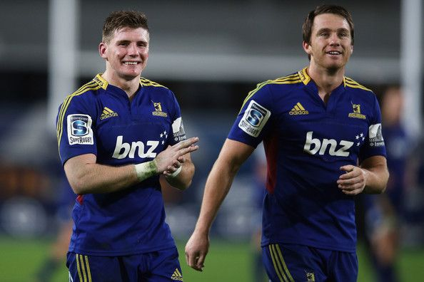 Colin Slade and Ben Smith of the Highlanders celebrate after winning the round 12 Super Rugby match between the Highlanders and the Sharks at Forsyth Barr Stadium on May 4, 2013 in Dunedin, New Zealand.