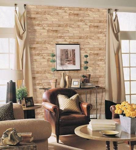 a parede de tijolo e a poltrona de couro marron... bonito!!!