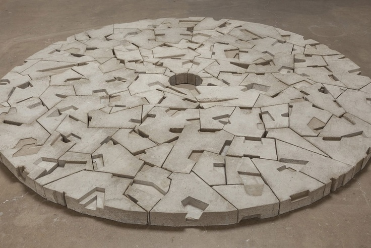 """Sculptor Gustavo Godoy's 'Vacant Mound (I)' (2012) made of cast concrete measuring 120 x 120 x 4"""" is on display at the artist's second solo exhibition 'Vacant Mounds and Markers' hosted by the Honor Fraser Gallery in Los Angeles, California, which runs from June 02 to July 07, 2012."""