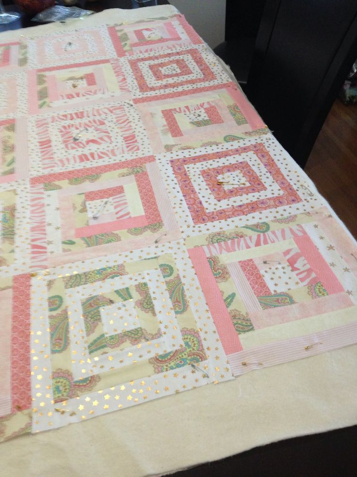 The pink baby quilt in progress.