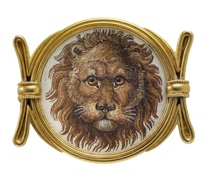 Archaeological Revival Micromosiac Brooch by Castellani, forming a circular micromosaic panel with the head of a male lion against a cream ground, set in a gold frame flanked by two batons highlighted with twisted gold wire. Signed to the reverse with Castellani's mark of two interlaced C's. Rome, circa 1870.