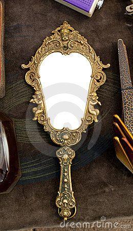 Vintage hand-held mirror by Viktorfischer, via Dreamstime ...