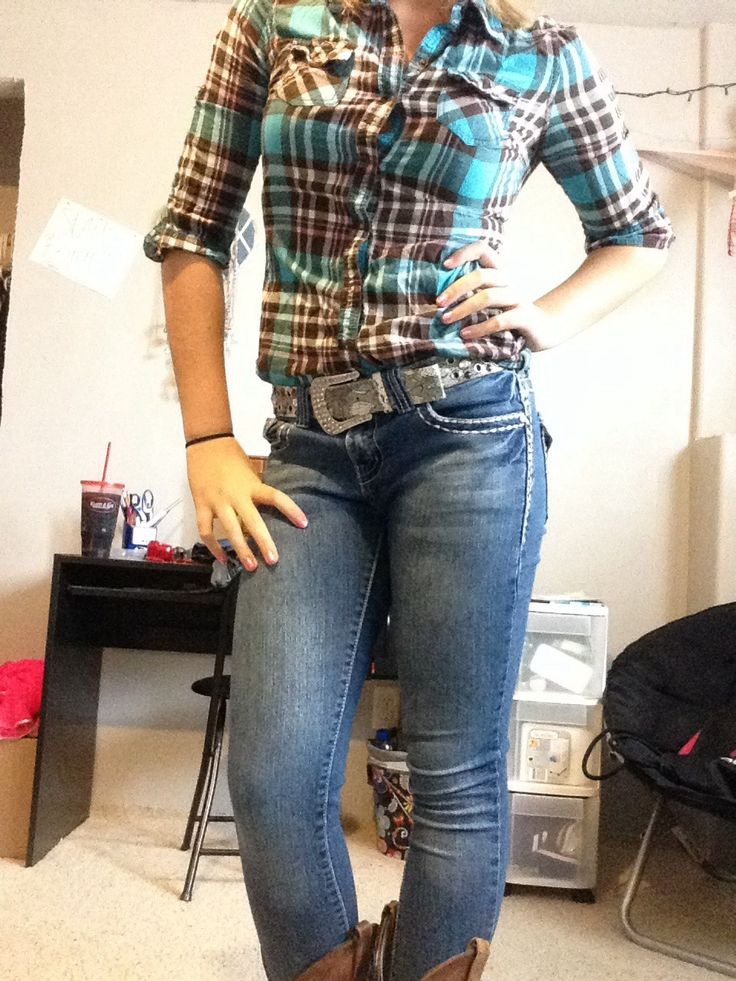 plaid shirt, jeans, cowboy boots                              …