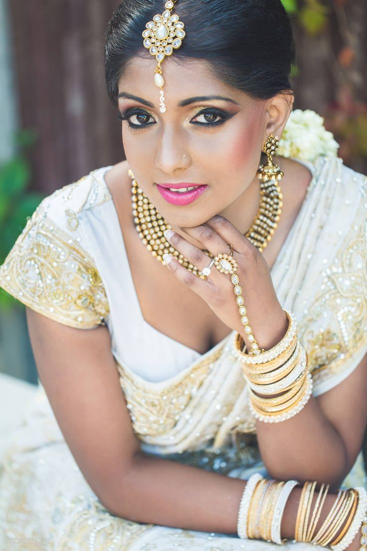 Traditional Indian bride wearing bridal saree and jewellery.