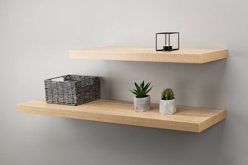 Our wooden shelves store and display your favorite photographs, candles and more. Create your own art gallery with these versatile shelves in the living room, bedroom or even a hallway. Made from reclaimed oak tree wood, these shelves are a friend to the environment…and to your home. Shelves are sold individually, but they look wonderful together, positioned at varying heights.